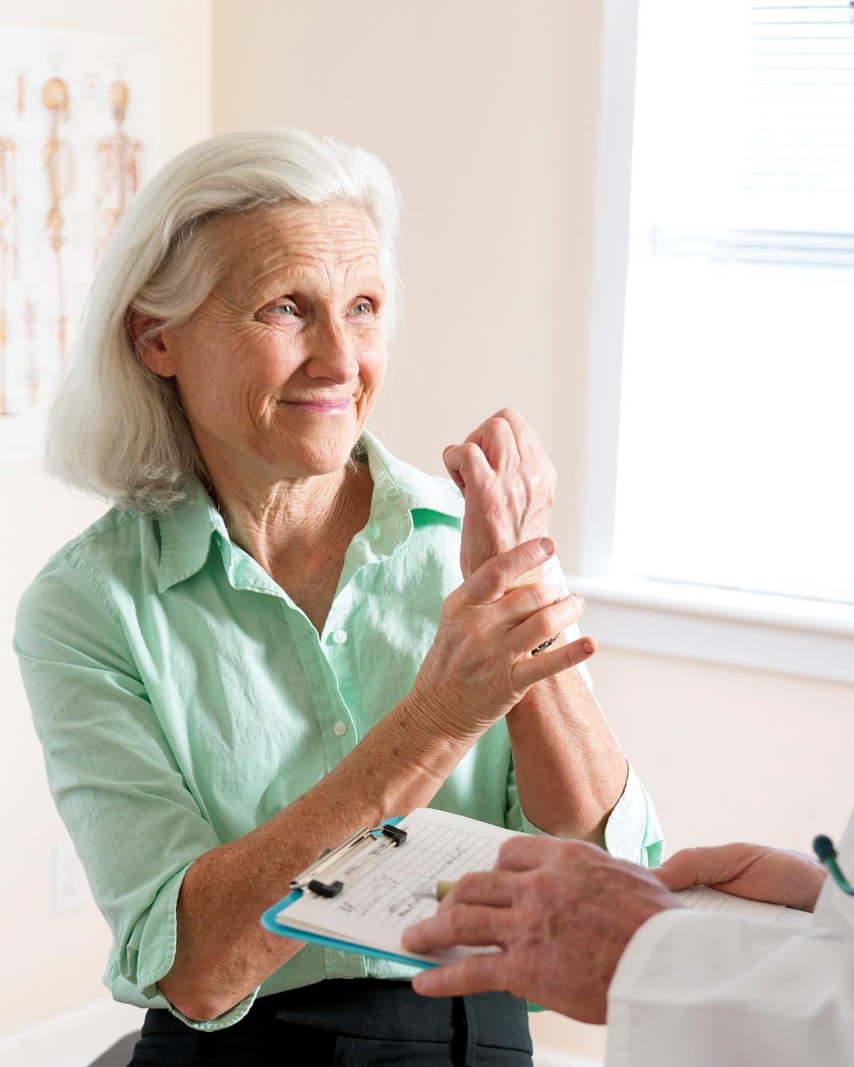 Woman Holding Wrist - Carpal Tunnel Syndrome