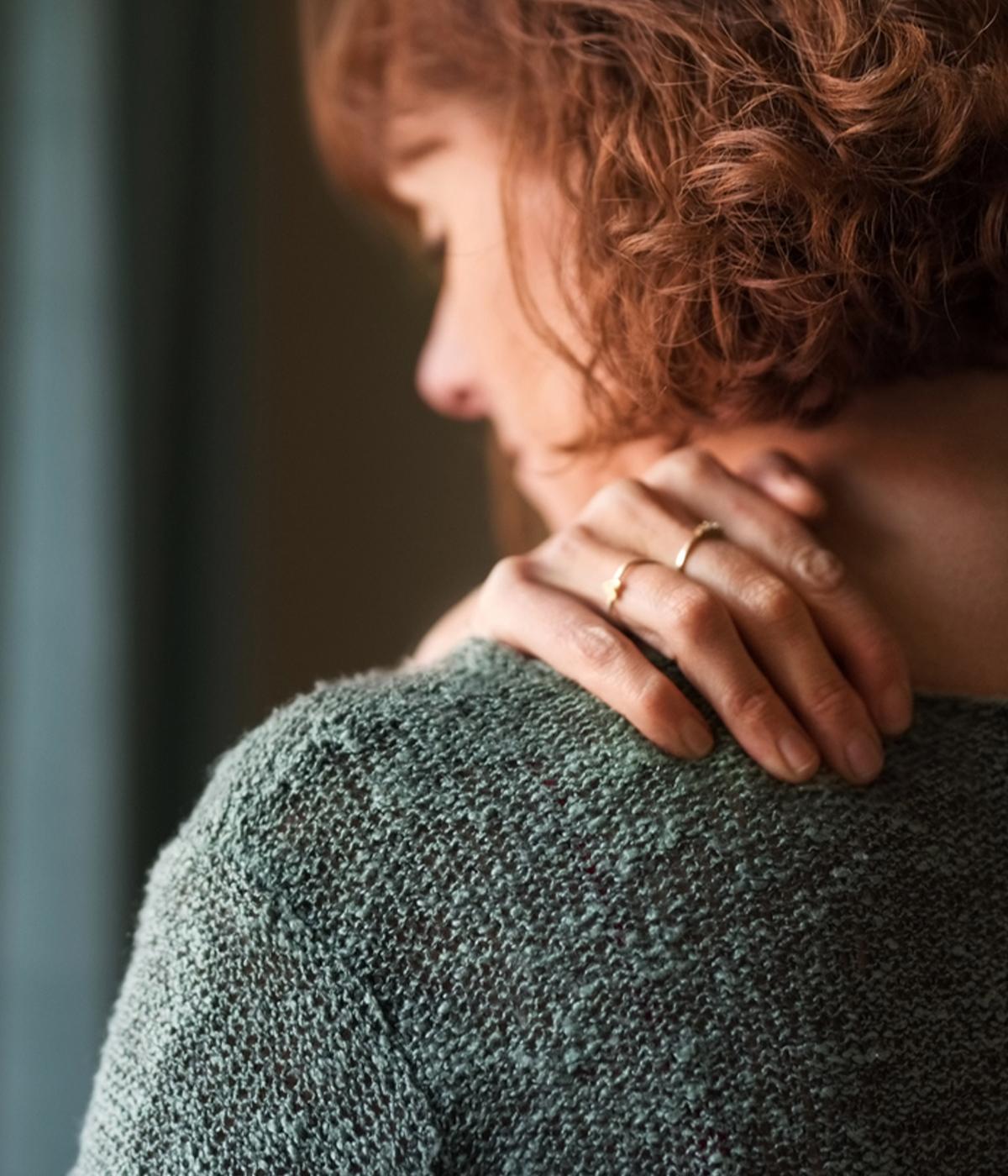 Woman grabbing shoulder because of Shoulder Pain