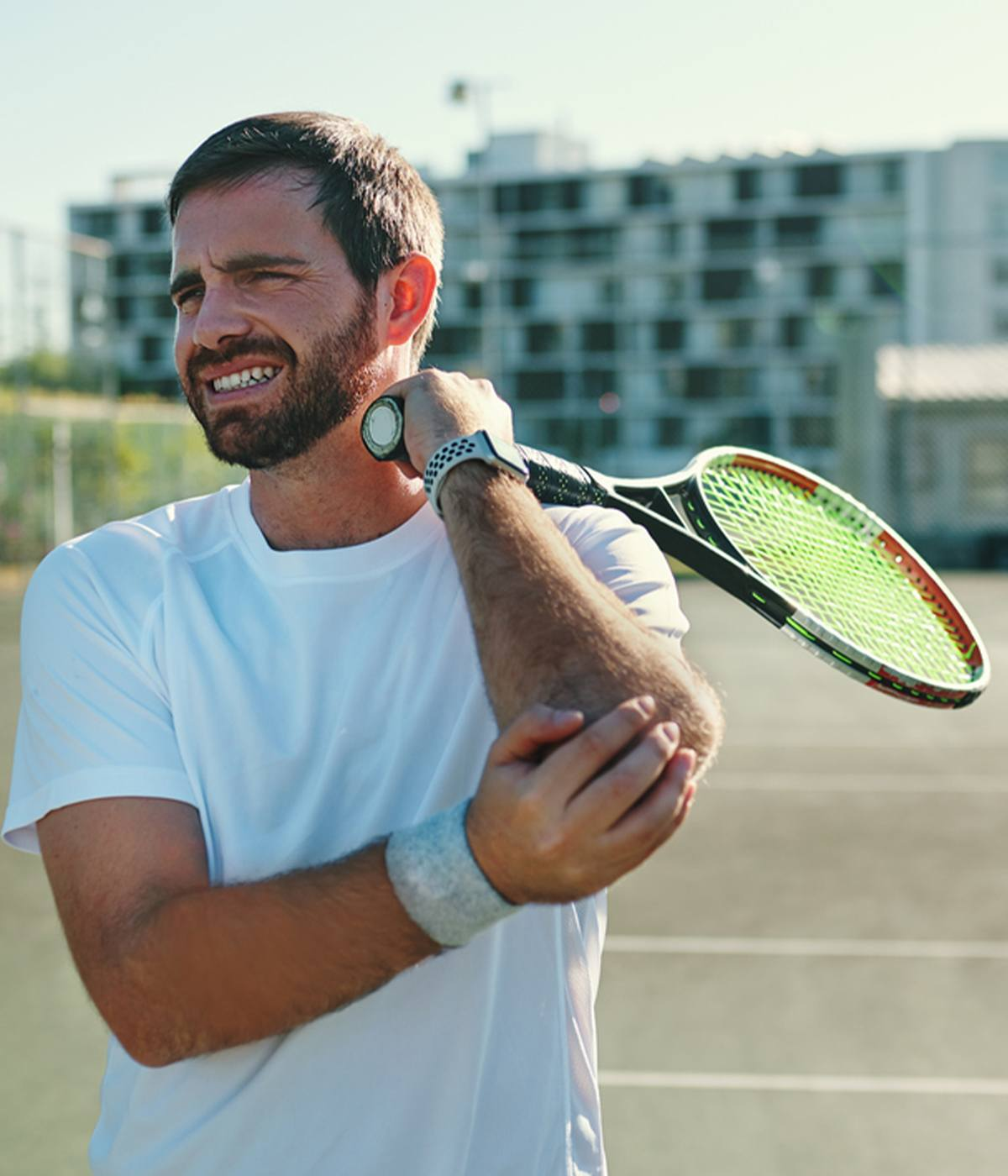 Male tennis player suffering from Tennis Elbow